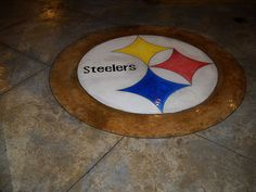 This dedicated sports fan shows his team pride with this custom concrete logo.  Patrick Breen Decorative Concrete Mullica Hill, NJ