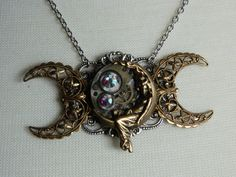 STEAMPUNK GODDESS - Triple Moon Goddess Necklace by Crow Haven Road. $45.00, via Etsy.