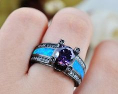New and different, blue opal amethyst goth ring! Order yours now! Blue Opal, Purple Amethyst, Unique Rings, Beautiful Rings, Antique Engagement Rings, Gold Filled Jewelry, Promise Rings, Wedding Engagement, Black Gold