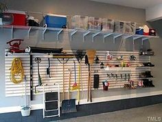 Garage with the Slat wall, adjustable shelving, epoxy floors, fresh paint. Now it's clean & easy to find everything! Storage Shed Organization, Garage Organisation, Garage Storage Solutions, Diy Garage Storage, Garage Shelving, Garage Shelf, Storage Ideas, Garage Doors, Garage Workbench