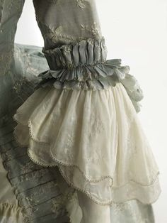 Fashion 18th Century ball gown dress ensemble costume circa from 1752-1775. Made from very fine silk, lace and trim with embroidered small flower floral pattern in off white woven into the pale blue background.