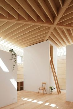 Light Walls House, Aichi, Japan by mA-style Architects - All four walls of the Light Walls House in Aichi, Japan are nearly void of windows. Yet the interior of this home is surprisingly bright. Natural light pours down from strategically placed skylights in the exposed wooden beam ceiling.