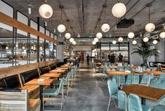 Dropbox opens industrial-style cafeteria at California headquarters — Dezeen Cafe Seating, Office Seating, Cafe Industrial, Industrial Style, Design Logo, Design Poster, Layout Design, Mensa, California