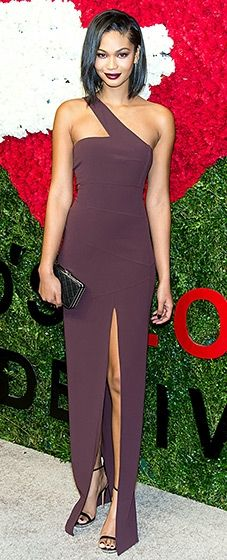 Chanel Iman went full glamour girl in an eggplant dress by Michael Kors with an up-to-there slit and a perfectly matched purple statement lip.
