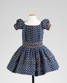 This is a charming child's dress that would have been worn by a boy or a girl. Date: 1850–55 Culture: American Medium: wool, silk Dimensions: Length at CB: 19 in. (48.3 cm) Credit Line: Brooklyn Museum Costume Collection at The Metropolitan Museum of Art, Gift of the Brooklyn Museum, 2009; Gift of The Jason and Peggy Westerfield Collection, 1969