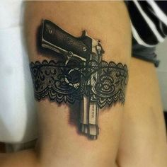 Black And Grey Gun And Belt Tattoo On Thigh