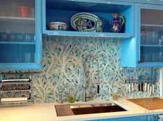 Climbing Vine backsplash in Quartz and Aquamarine glass.  By New Ravenna Mosaics.