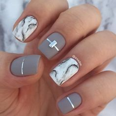 A very luxurious manicure that is enhanced with this look of marble on two nails.