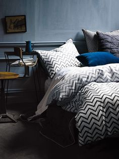 Chevron sheets with dramatic grey walls. Luxurious.