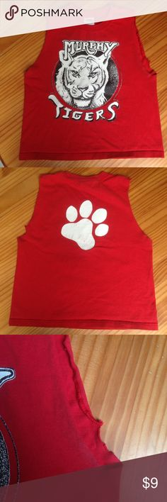 Vintage school spirit cropped tank. Bright red with sweet tiger logo on front and paw print on back. Logos are a bit worn but just gives it that vintage look. Armpits are a bit worn from the raw cut (all pictured). Marked 6/8 fits like a women's small/medium. Tops