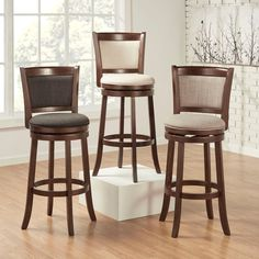 Impress your guests with this swivel back pub chair in linen. It is comfortable and sturdy enough for the man cave, but with cherry wood legs, is elegant and stylish enough to use for seating at a kitchen bar or island.
