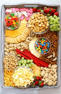 Creating a Movie Night Snack Board is a fantastic family night in idea to enjoy all your favorite snacks like fresh fruits, cheeses, crackers, popcorn and candy while watching the newly released Dolittle DVD! Charcuterie Recipes, Charcuterie Platter, Charcuterie And Cheese Board, Cheese Boards, Snack Platter, Party Food Platters, Snack Trays, Platter Ideas, Food Trays