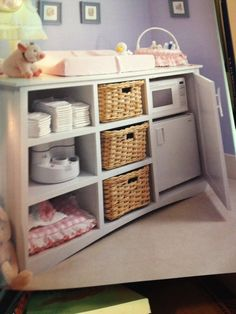 mini-fridge in nursery for bottles...genius...I would change the microwave as its bad for bottle and find an alternative