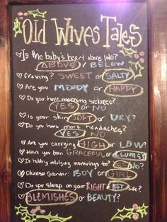 Old wives tales chalkboard sign at the ugly sweater gender reveal party