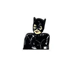 Catwoman from Batman returns soft enamel pin. 1.75 inch tall with 2 rubber backs.