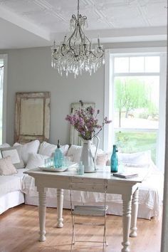 Maria from Dreamy Whites creates beautiful rooms seemingly effortlessly with white, linen and weather-worn items. Although she describes her style as French farmhouse inspired, since the rooms are feminine, some may call her style shabby chic.