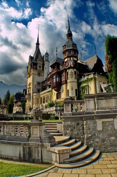 Peles Castle, Romania; the clouds and sky look almost painted here.