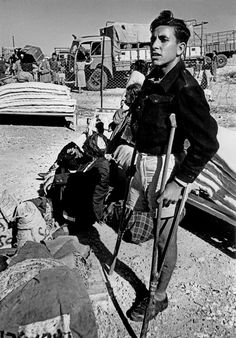 1950 Upon their arrival at the port of Haifa, new immigrants were placed in a receiving camp of Shaar Aliyah, where they would be housed until permanent accommodation could be found for them (Robert Capa)