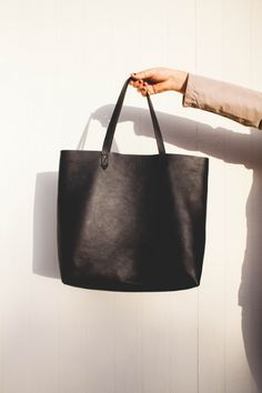 Well, now I need a black one...  madewell transport tote black.