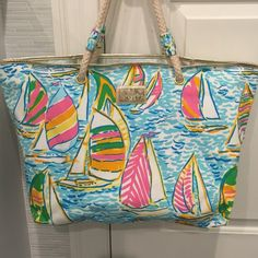Lilly Pulitzer Shoreline Tote You Gotta Regatta! Canvas bag with waxed interior. Rope handles. Interior zip pocket. Will part with this bag for the right price. Lilly Pulitzer Bags Totes