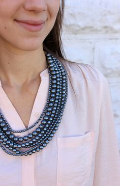 Layered smoky pearls make for a luxe look!
