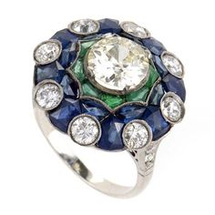 Sapphire Emerald Diamond Ring   From a unique collection of vintage cocktail rings at https://www.1stdibs.com/jewelry/rings/cocktail-rings/