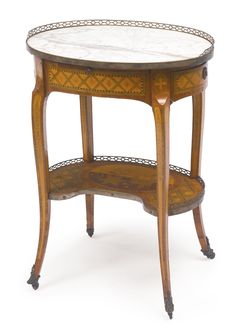 A Louis XV/XVI transitional ormolu-mounted tulipwood, fruitwood and marquetry table en chiffonnière - circa 1770