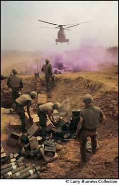 Smoke marked the zone for helicopters ferrying in supplies. Near Khe Sanh, April 1968.  By Larry Burrows