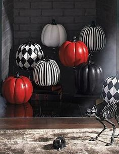 Stylishly celebrate Halloween while avoiding messy carving with the Designer Pumpkin; simply choose your favorite color, or get them all to create a festive scene.