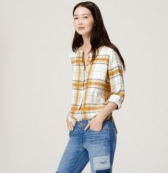 In fresh-yet-relaxed plaid, this airy piece is your perfect wardrobe partner. Collarless. Long sleeves with button cuffs. Henley button placket with bottom pleat. Box pleat beneath back yoke. Shirttail hem.