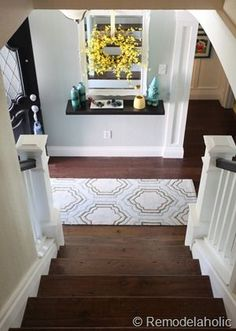 Remove carpet from stairs with this simple stair makeover from Remodelaholic.com. FREE custom newel posts plans included.