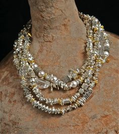 AllisonBellowsJewelry.com  Sterling Silver, 24K Gold Vermeil.  Each one is one of a kind.