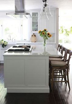 Kitchen Island With a Stove: Ideas and Inspiration | Hunker Kitchen Island With Cooktop, Island Cooktop, Kitchen Island Storage, Kitchen Peninsula, Farmhouse Kitchen Island, Kitchen Island Decor, Modern Kitchen Island, Kitchen Island With Seating, New Kitchen