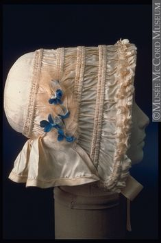 Silk satin bonnet with tulle and artificial flower trim, c. 1845.