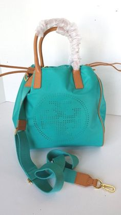 7a113f89826 Tory Burch Small perf Logo drawstring tote crossbody  turquoise Nylon  leather  ToryBurch  TotesShoppers