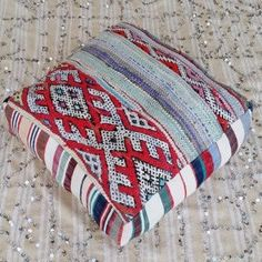 Colorful vintage Berber kilim Moroccan rugs and textiles have been artfully up-cycled to make this beautiful one of a kind floor cushion. #pillows #globalstyle #globaltextile #bohemian #Moroccan #FloorCushions
