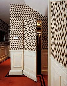Doors painted the same color as walls to blend in and stay hidden. You can use paint, wallpaper, trim, or all of the above!