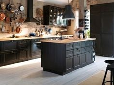 15 Beautiful Black Kitchens /// The Hot New Kitchen Color I'm really feeling this open space…the light brick with the black creates such a contrast …then blended with the open pot rack and glass door cabinets…it is so totally inviting. Black accents are e Home Kitchens, Kitchen Remodel, Kitchen Design, Kitchen Cabinet Design, Black Kitchens, Kitchen Inspirations, New Kitchen, Kitchen Interior, Trendy Kitchen