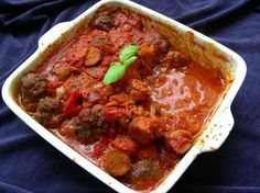 Italian Tomato Sauce With Meatballs and Sausage from Food.com:   My best Italian Sauce.  I make big batches and freeze it in containers for those nights we want a quick meal.   My son says there is no better smell then the smell of my sauce simmering on the stove.  I allow them a quick taste by dipping with a slice of Italian Bread.