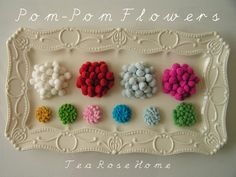 Tutorial Pom-Pom Flowers - what a great way to use up smidgeons and scraps of pom-pom trim, no matter what the size trim used - great step-by-step instructions, as well.