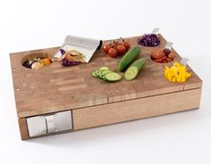 Chopping board with waste chute and in built containers. Lovely.