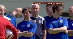 James McAvoy standing on side line with actor Michael Sheen for team #Rest of the World against England for charity event 'Soccer Aid' to benefit UNICEF in the UK on Sunday, May 27, 2012.