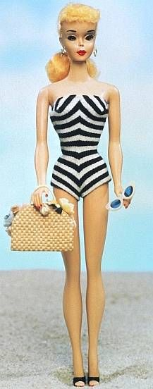The original Barbie doll was launched in March 1959. My mom still has hers. I loved playing with her Barbie and Ken. So cool!!