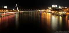 Night panorama on Bratislava Castle and St. Martin's cathedral from the UFO New Bridge Restaurant.   Night Panorama shows the New Bridge with UFO Restaurant and Bratislava castle on the right side of river Danube.  (c) Maroš Žilinčan Photography / http://bratislava-slovakia.eu