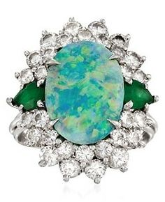 C. 1970 Vintage Australian Black Opal Ring With Diamonds and Emeralds in Platinum. Size 5