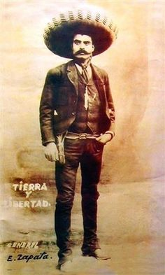 Not to trivialize the man's importance at all, but here's Emiliano Zapata in a perfectly cut suit.