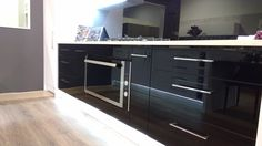 Showroom Kitchen, Gloss Black and White with Stone Bench in Mirror White. KRUS Hamilton NZ