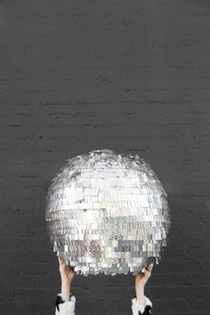 How fun would this DIY disco ball piñata be for the New Years celebration?