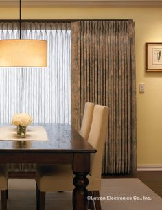 add a little technology to your traditional dining room with remote controlled drapery from lutron
