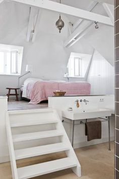 Like the little step up to the bed! The all white and small hint of pink is adorable as well!